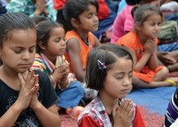 Children in Prayer in Jerusalem, Israel and Papua, Indonesia